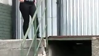 Big ass girl in leather boots pees outdoors