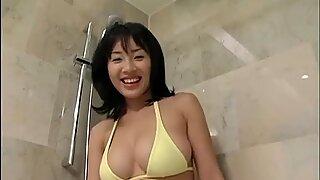 Kinky and sexy black haired Asian Megumi Kagurazaka takes a bath