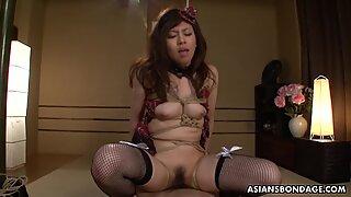 Sayumi Matsushita riding tightly wrapped in ropes