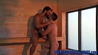 Muscled hunks are ready for some hardcore spooning in this scene