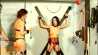 Two hot and horny slaves get tied and spanked while playing with each other