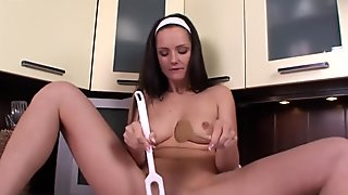 Sexy house wife uses speculum in kitchen