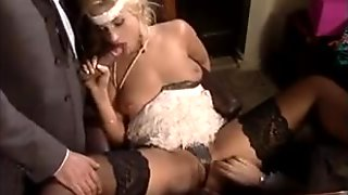 Classy blonde in stockings enjoys a threesome