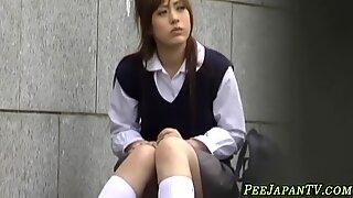 Japanese teen rubs pussy